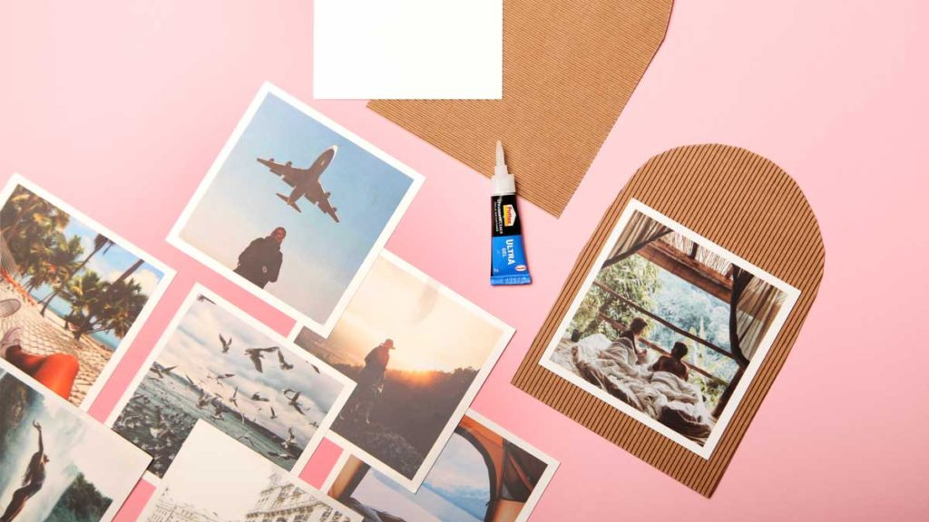 Glue the photos for the World travel map with pins
