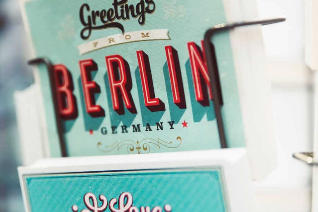 'Greetings from Berlin' postcard in the wrack