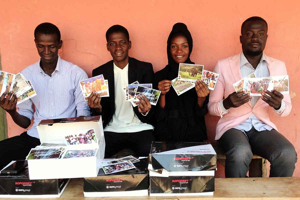 School Building - The Team of the Yarinaa Foundation with Postcards
