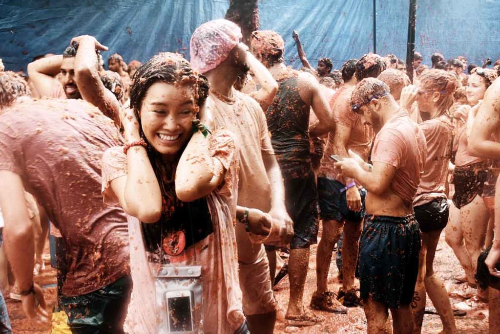 Crowd with tomatos on the cultural festival La tomatina
