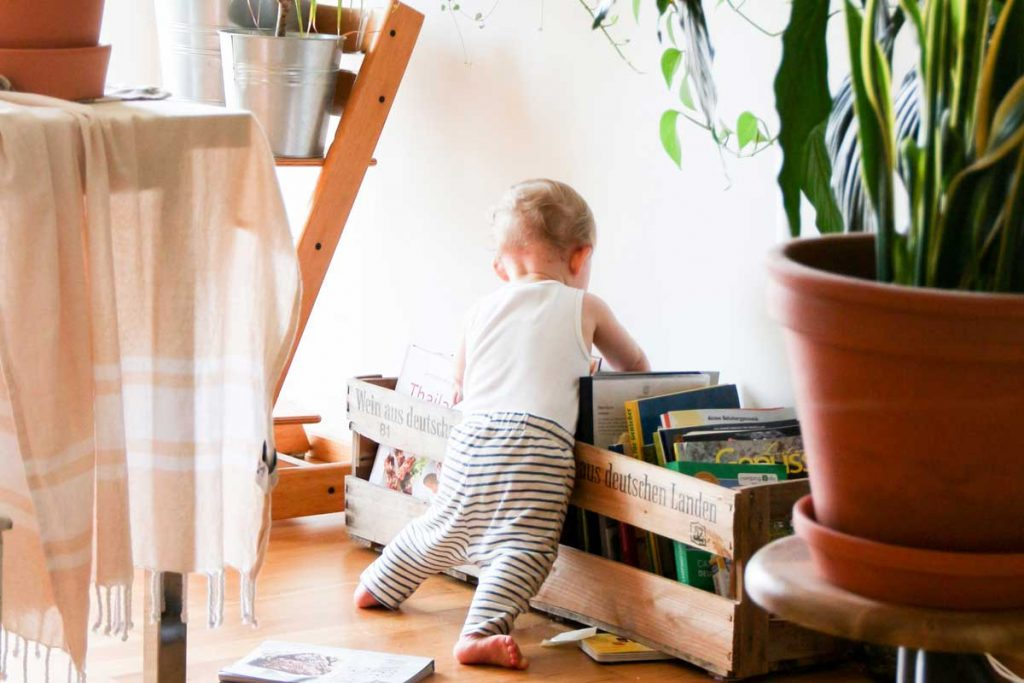 Toddler playing with books