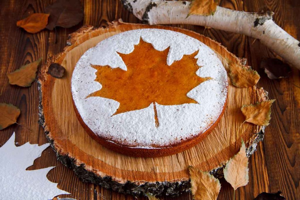 Homemade pie with a maple leaf