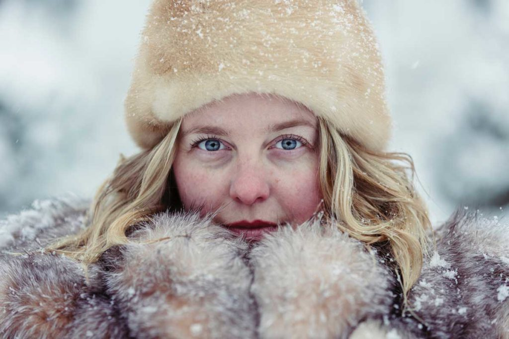 Portrait of a woman with hat and mittens in winter