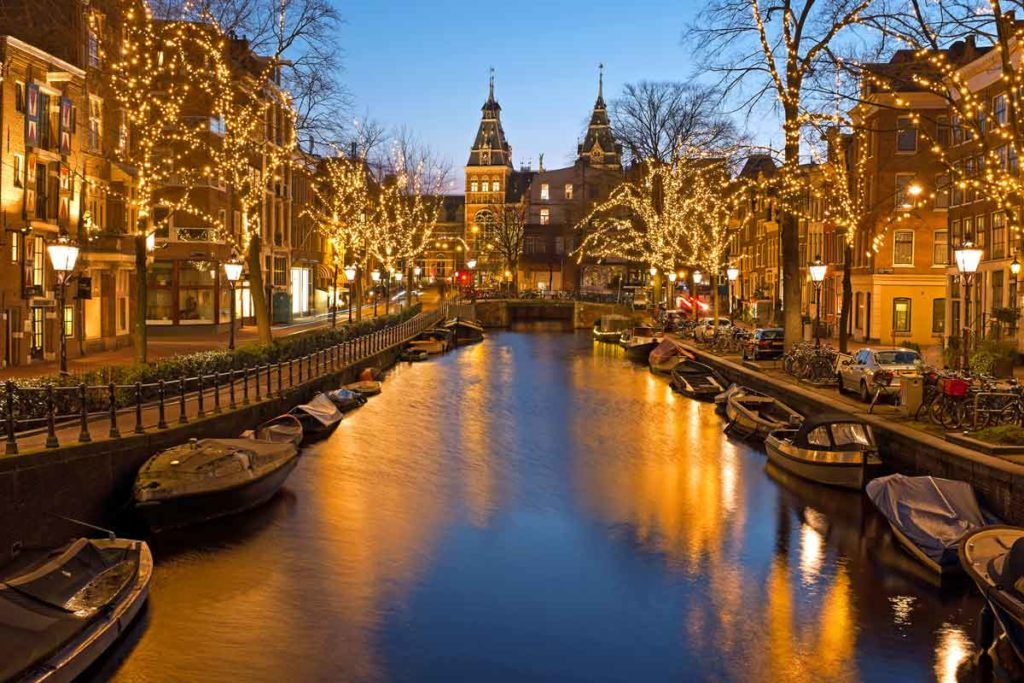 Boats on a canal in Amsterdam with Christmas lights