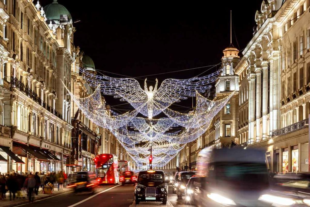 A street in London with Christmas lights and traffic