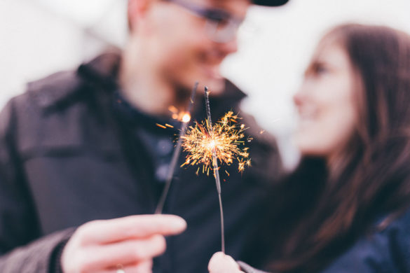Couple holding a sparkler for New Year's Eve