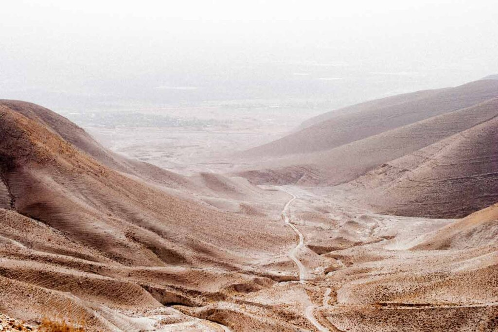 An orange desert valley from setting of must-read 'The Innocents Abroad'