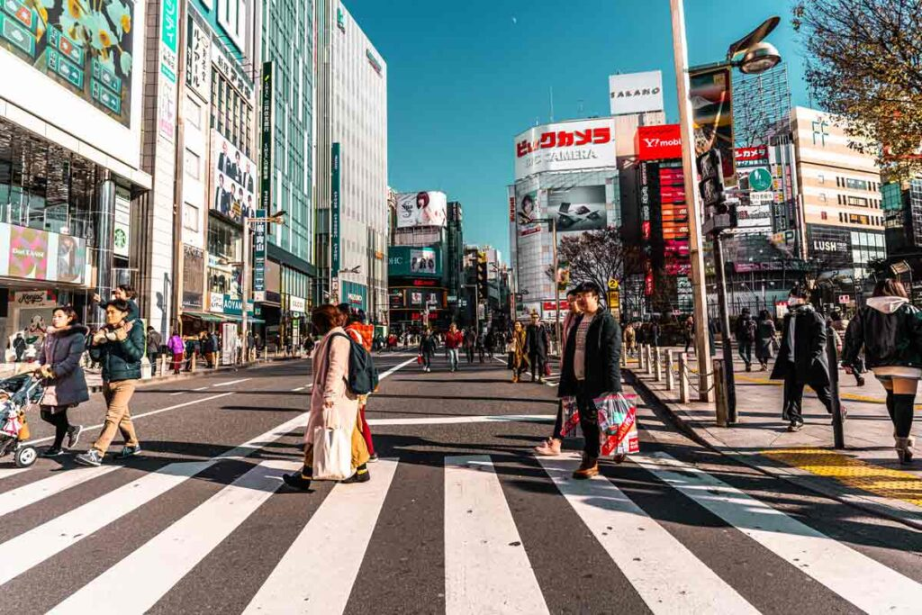 People cross the road on a busy street in Tokyo - the perfect setting for a travel movie