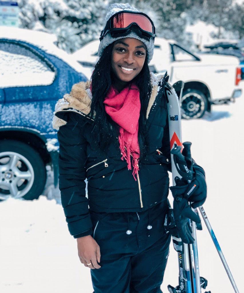 Efia stands in the snow smiling