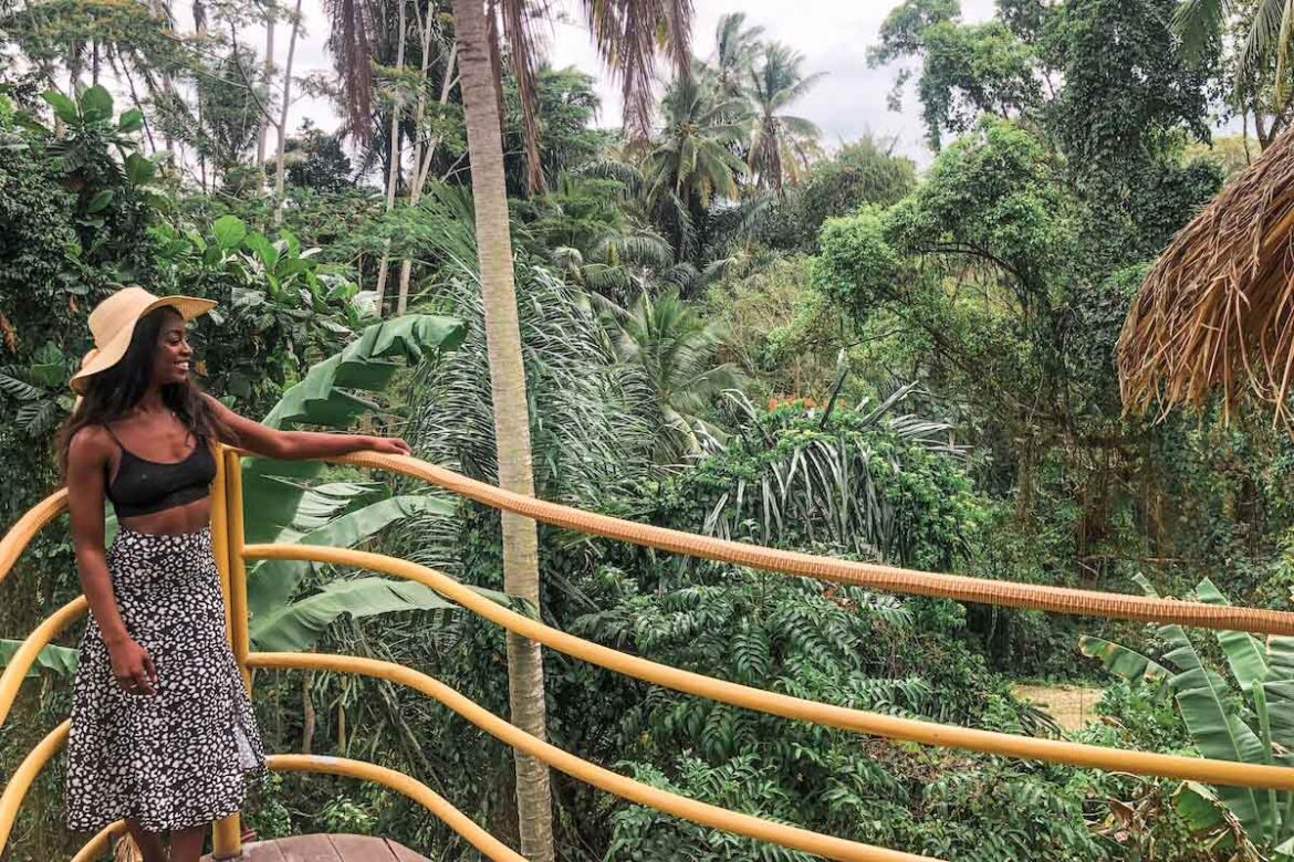 Efia stands in a forest