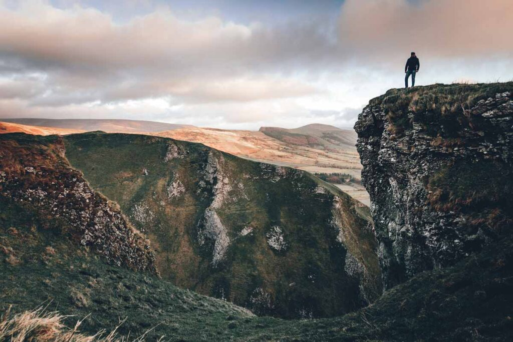 Jagged cliffs with hikers in the Peak District make the perfect getaway for Londoners