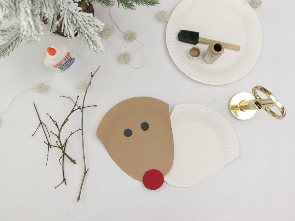 Step 4 in making a Rudolph plate with the children - glue the eye nose and plate shapes to each other