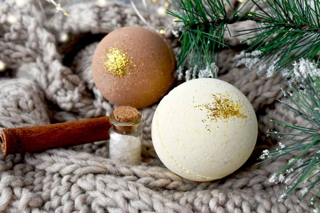 Easy homemade winter bath bombs with gold glitter under a Christmas tree