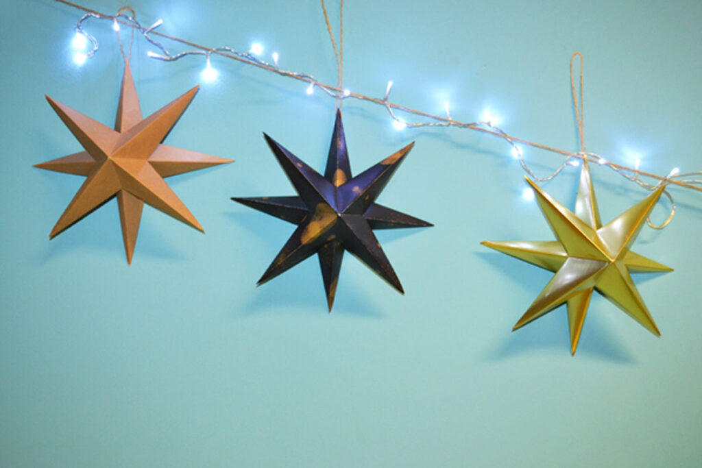 Final step to making easy Christmas orgiami decorations