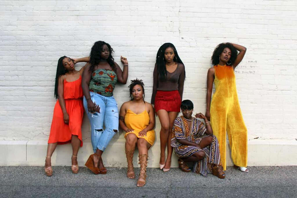 Fashionable black women pose for a photo