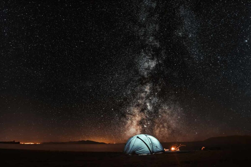 The stars shown spectacularly over a lit tent