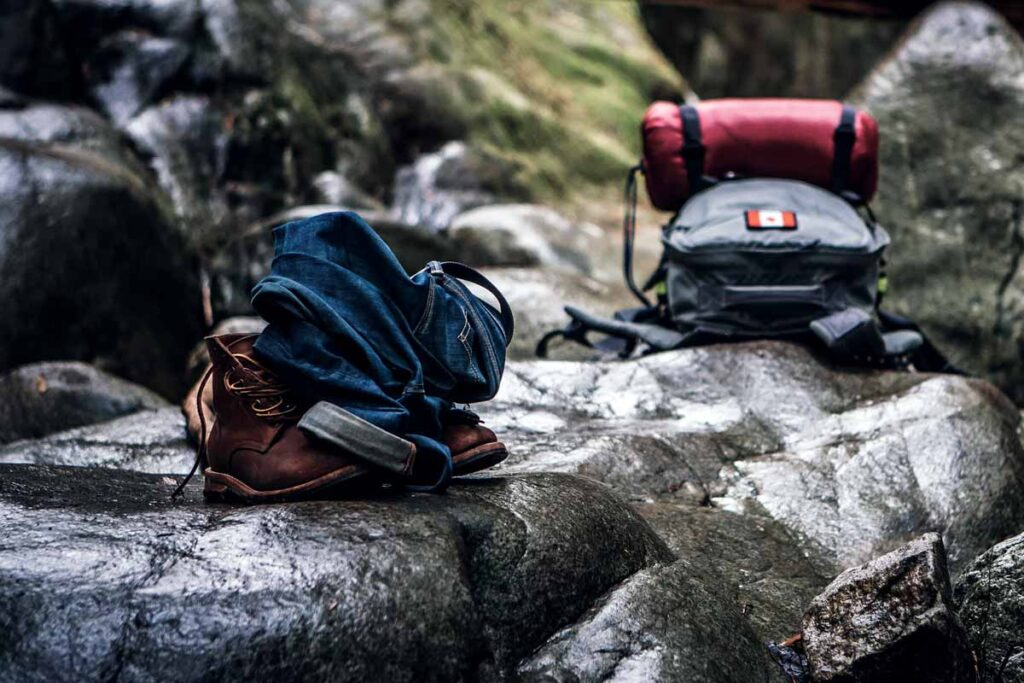Two backpacks lie on the rocks having been packed well