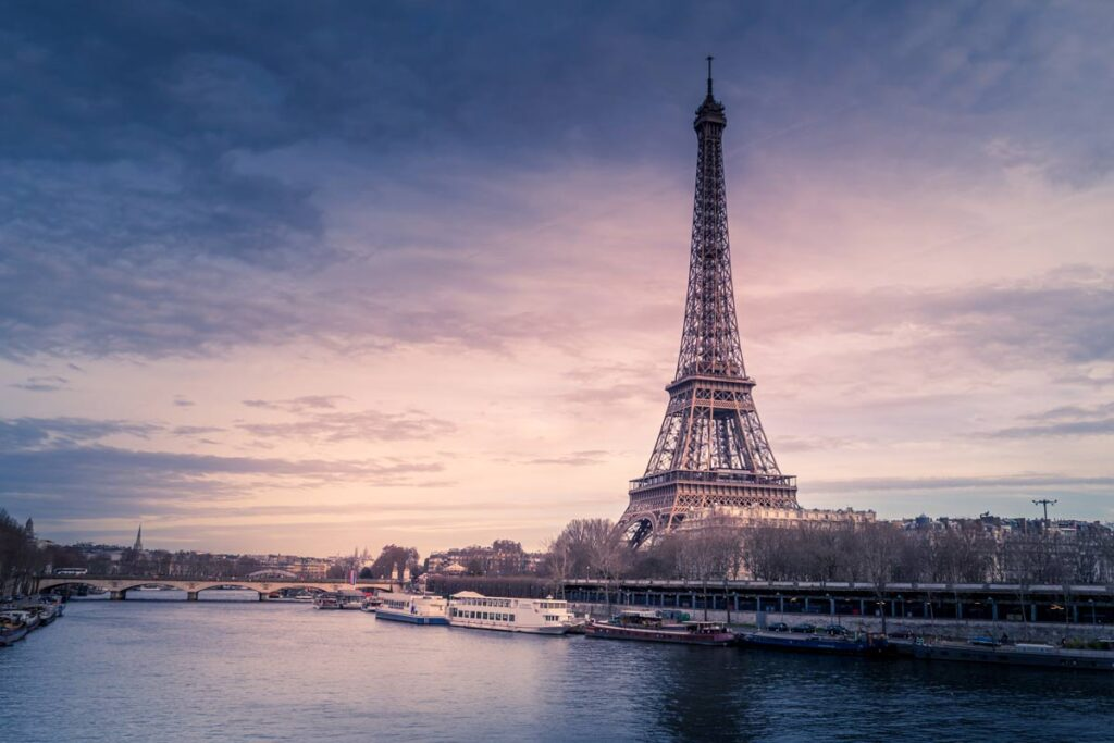 The Eifel tower at twilight towering over Paris, locations for many famous films