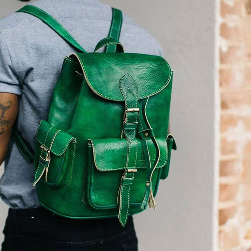 A jade green leather bag by black-owned lifestyle brand, Made Leather Co.