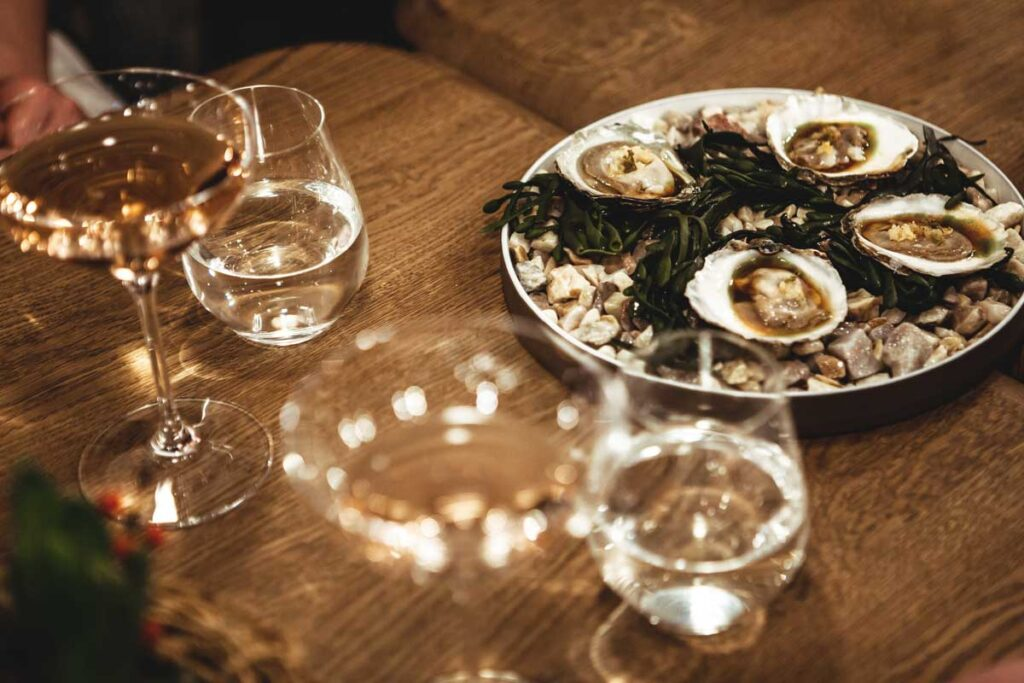 Champagne and oysters on the table