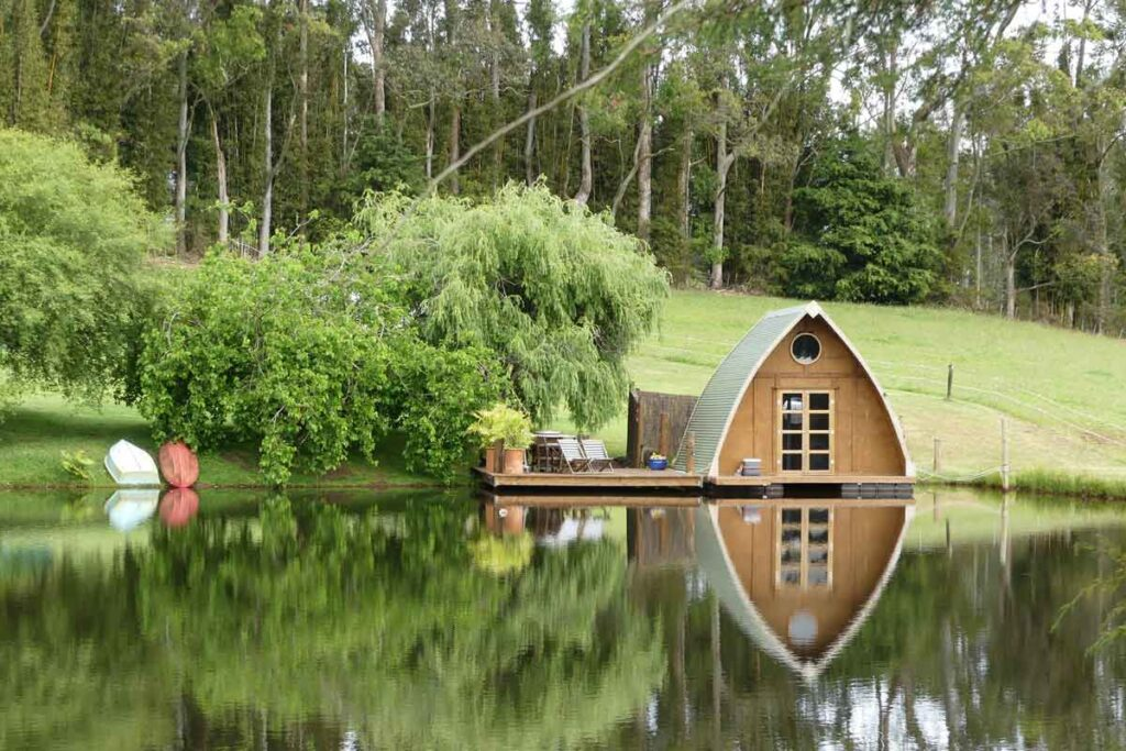 A miniature hut on the waterside for glamping experiences