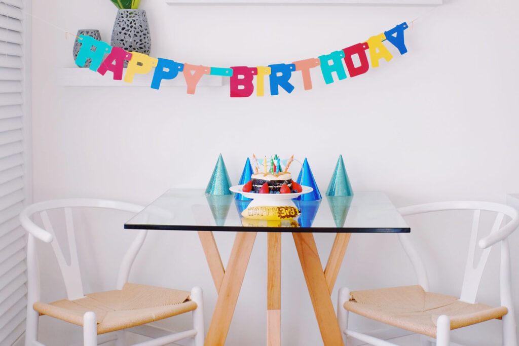 A scene of an office birthday wishes with party hats on the table