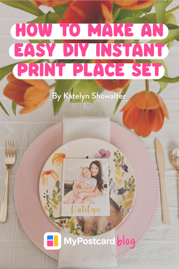 Pin for tutorial featuring a finished DIY instant print place set placed on top of a flowery plate. At the top of the picture is a title above some tulips