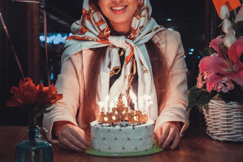 A girl sits ready to blow out her candles on her birthday cake