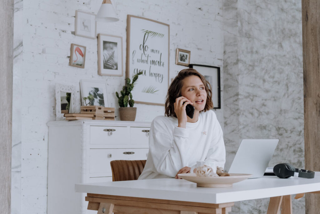 A woman on the phone providing inspiration inside her work from home space