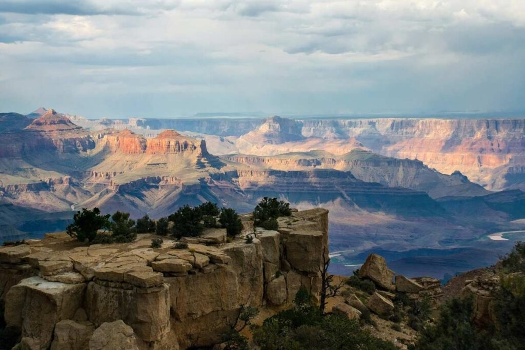 The most famous place to hike in the U.S. - the Grand Canyon, with pinkish rocks under blue skies