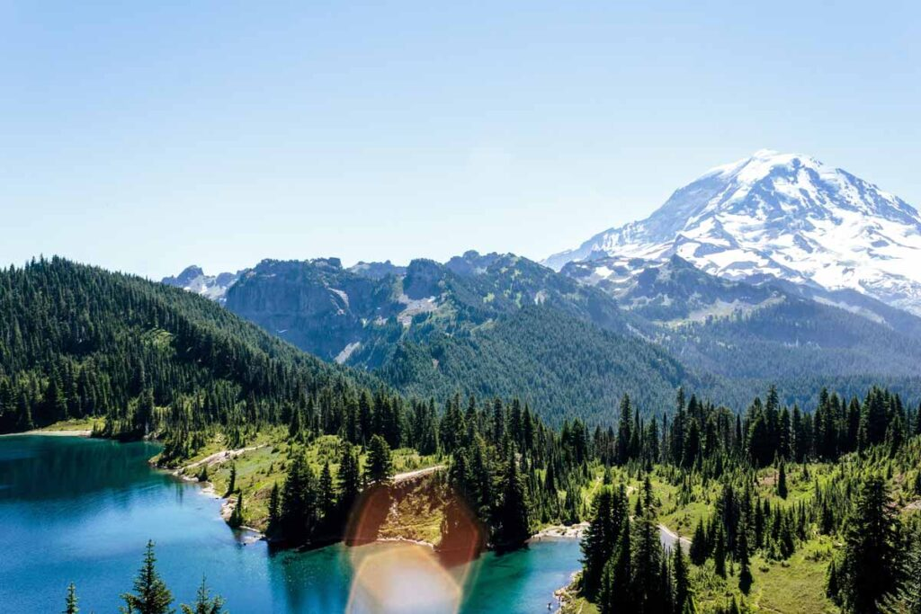 Snow topped mountains and lakes make Mount Rainier Park one of the best hiking trails in the US